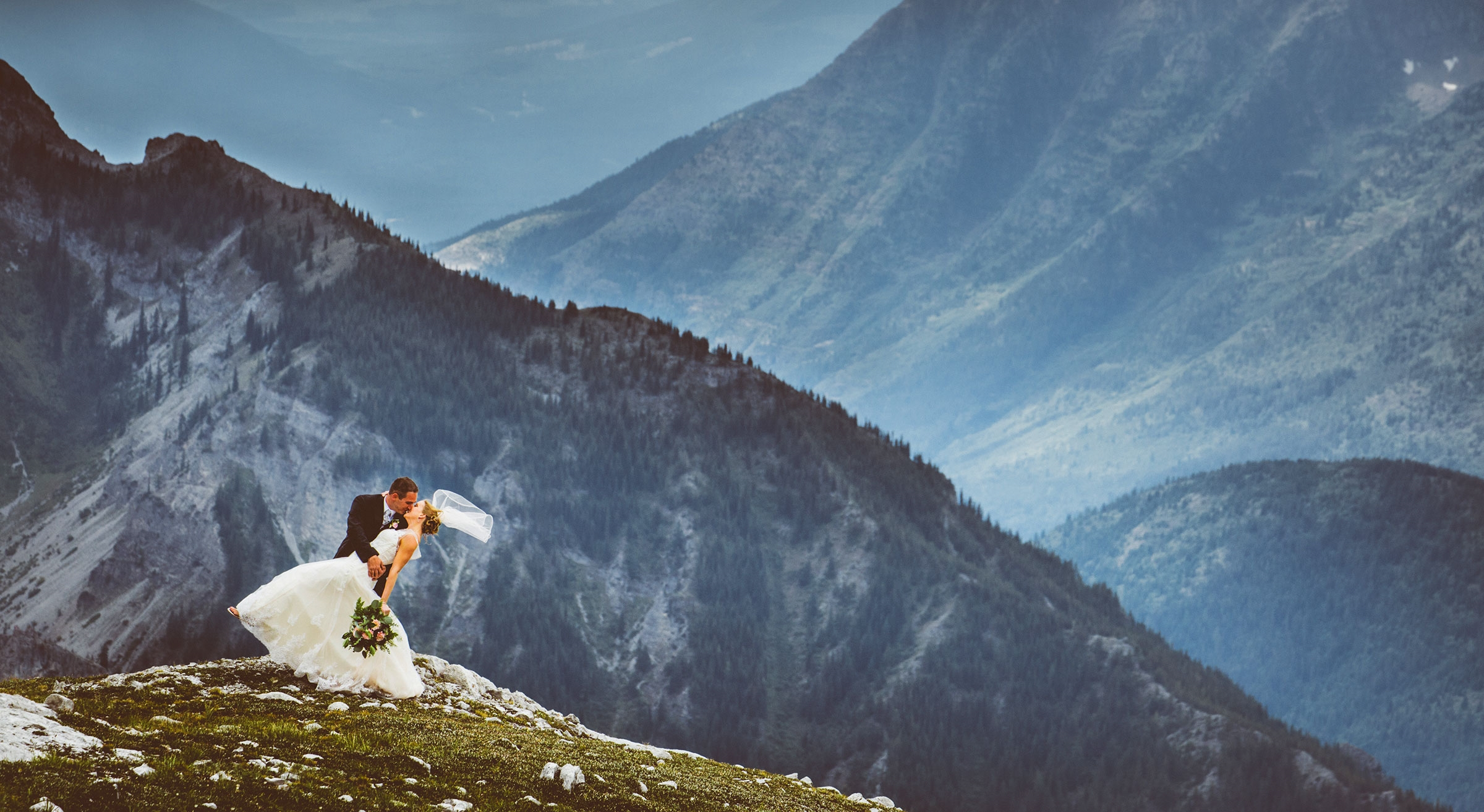 Wedding couple on mountain top