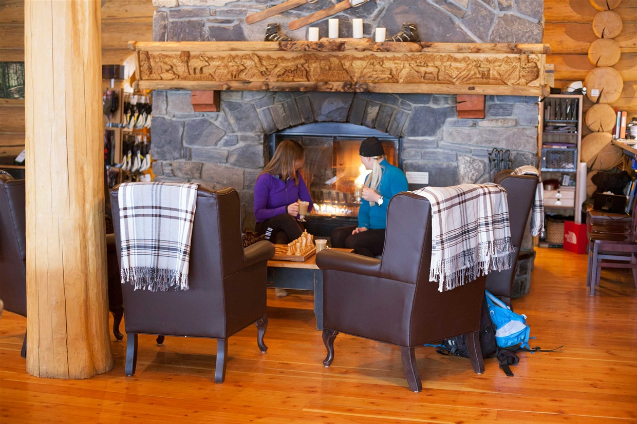 Enjoying the fireplace at Island Lake Lodge