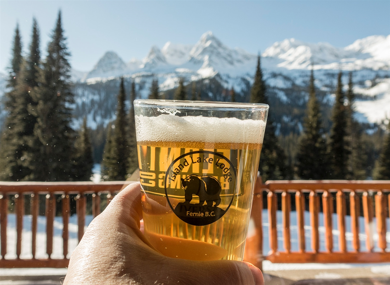Relaxing with a beer on the outdoor patio at Island Lake Lodge