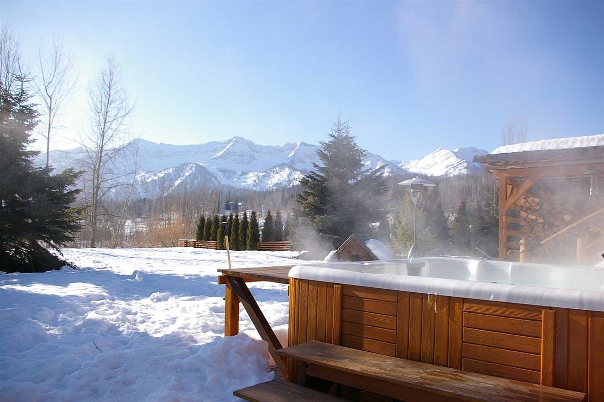 The lodge's welcoming outdoor hot tub