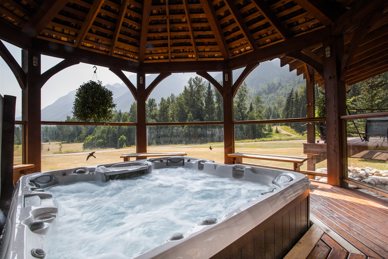 Relax in the hot tub with mountain views