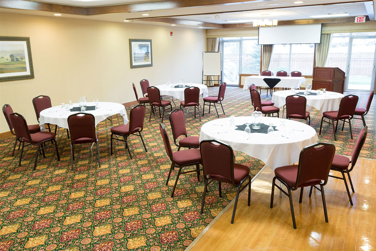 Round table set-up in the Mount Trinity Room