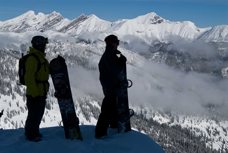 Snowboarders taking in the views at Island Lake Catskiing