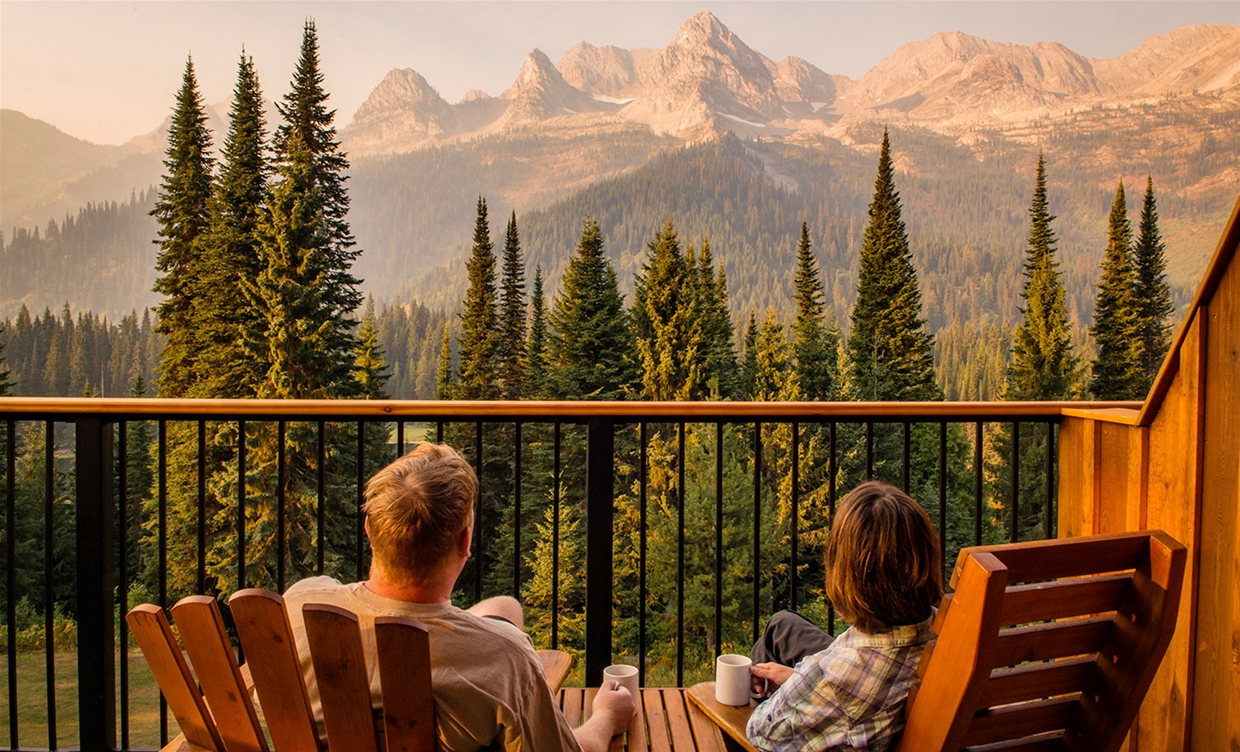 Couple enjoying views on their patio at Island Lake Lodge
