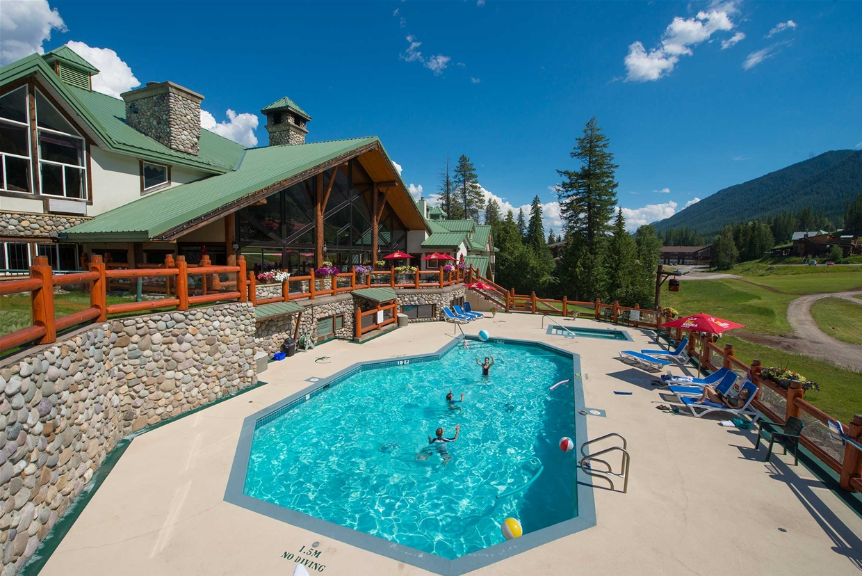 Summer aerial view of Lizard Creek Lodge & pool