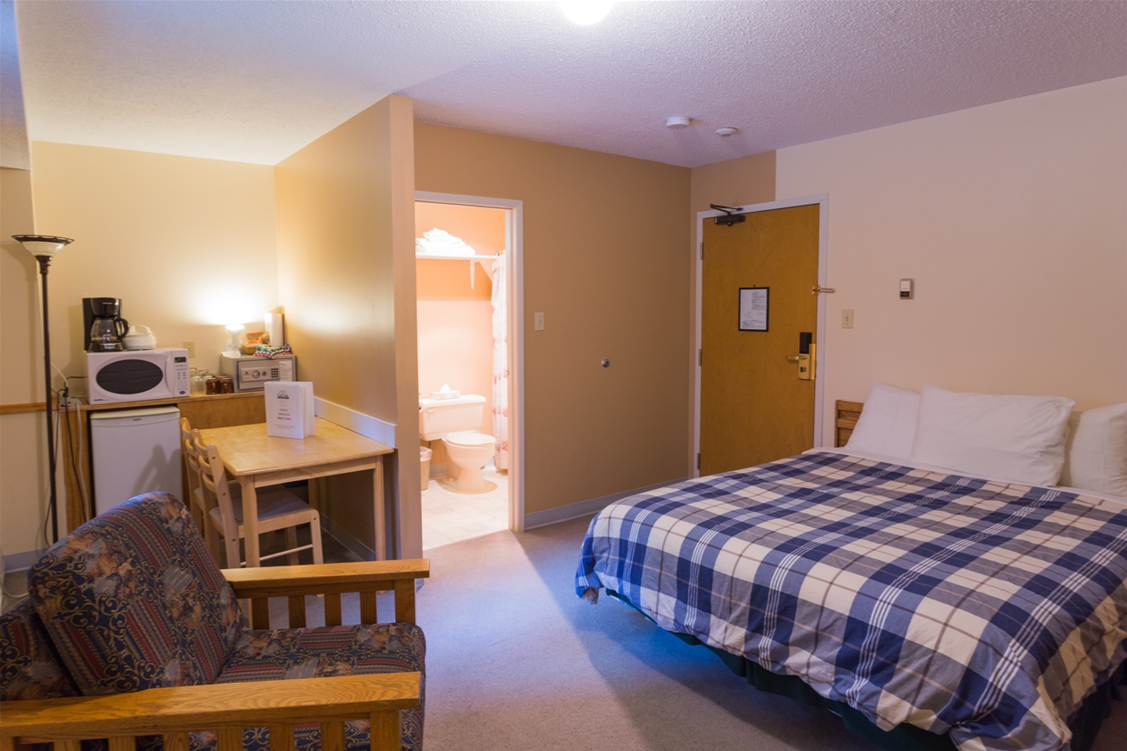 Compact Hotel Room at Griz Inn